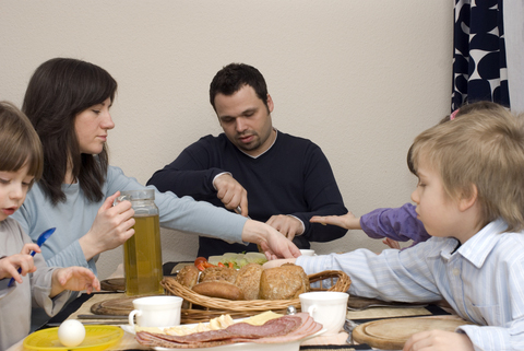 A family eating dinner together is an important part of work and life balance.
