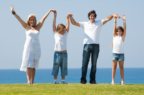 A family outdoors helps to achieve balance by reducing stress and bonding together.
