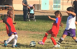 Kids playing soccer - it's important to know hydration tips for kids
