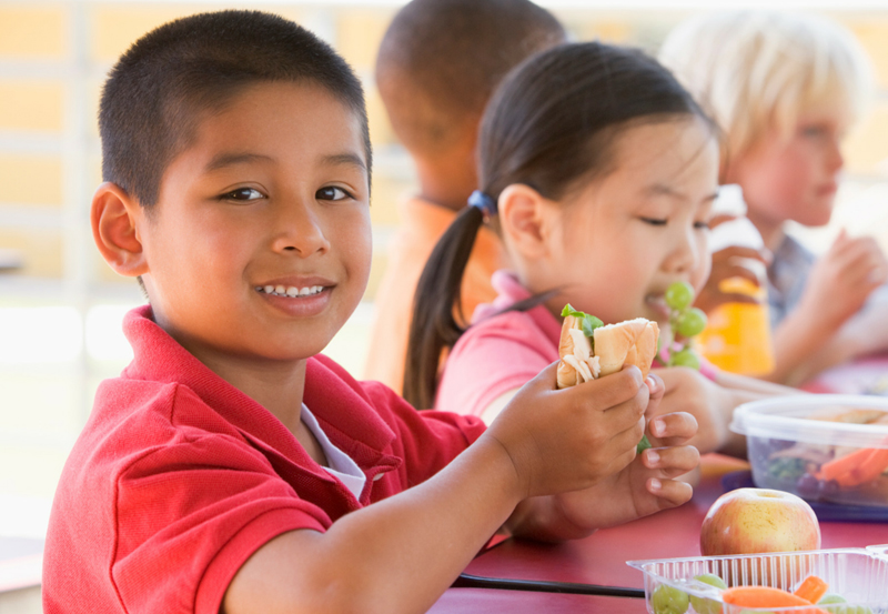 Kids at school lunch table for back to school simple healthy tips